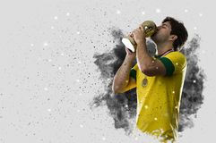 Brazilian soccer player coming out of a blast of smoke. celebrat Stock Images