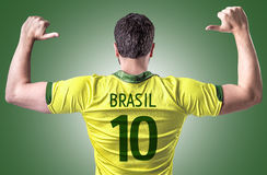 Brazilian soccer player on green background Royalty Free Stock Images