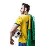 Brazilian soccer player holding the flag of Brazil and a ball on white background Stock Photos