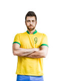 Brazilian soccer player looks serious on white background Stock Image