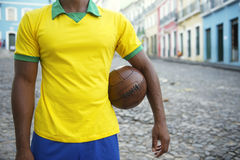 Brazilian Soccer Player Pelourinho Salvador Bahia Brazil Street. Brazilian soccer player standing on colonial Bahia street Pelourinho Salvador with vintage Stock Photography