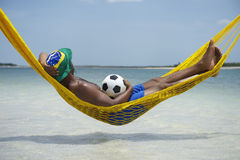 Brazilian Soccer Player Relaxing in Beach Hammock Stock Photography