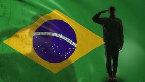 Brazilian soldier silhouette saluting against national flag military recruitment. Stock footage stock video footage