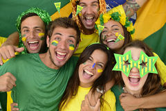 Brazilian Sport Soccer Fans Celebrating Victory Together. Royalty Free Stock Photo