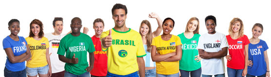 Brazilian sports fan showing thumb with 11 international fans Stock Photo