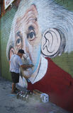 Brazilian street artist Sipros painting mural at East Williamsburg in Brooklyn. Royalty Free Stock Images