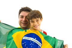 Brazilian Support. Happy Adult and child holding a brazilian flag Stock Image