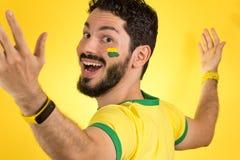 Brazilian supporter of National football team is celebrating, ch. Brazilian football fan emotions: celebrating, excited, happy. Supporter of Brazil national Stock Photo