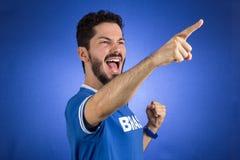 Brazilian supporter of National football team is celebrating, ch. Brazilian football fan emotions: celebrating, excited, happy. Supporter of Brazil national Royalty Free Stock Photos