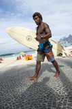 Brazilian Surfer Carrying Surfboard Arpoador Brazil Royalty Free Stock Photo