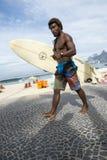 Brazilian Surfer Carrying Surfboard Arpoador Brazil Royalty Free Stock Photo