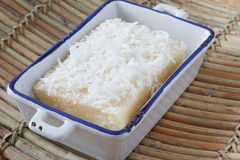 Brazilian sweet couscous (cuscuz doce) with coconut ion plate Stock Images