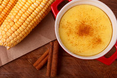 Brazilian sweet custard-like dessert curau de milho mousse of co Royalty Free Stock Photos