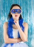 Young Brazilian asks for silence, secrecy and mystery. Gesticula. Brazilian teenager is asking for silence. Secret, mystery. Finger on lips. Woman costumed for Royalty Free Stock Image