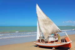 Brazilian traditional sailing boat. Typical Brazilian fishing boats in the beach Royalty Free Stock Photo