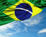 Brazilian waving flag on a beautiful day Stock Photos