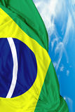 Brazilian waving flag on a beautiful day Stock Photography