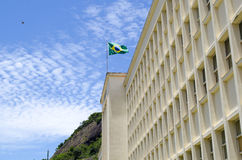 Brazilian waving flag in a militar buildings. Under a great blue sky Stock Photo