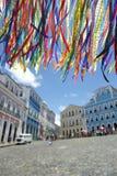 Brazilian Wish Ribbons Pelourinho Salvador Bahia Brazil. Colorful Brazilian wish ribbons waving in the sky above colonial architecture of Pelourinho Salvador Royalty Free Stock Photo