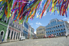 Brazilian Wish Ribbons Pelourinho Salvador Bahia Brazil. Decorative Brazilian wish ribbons waving in bright sky above colonial architecture of Pelourinho stock image