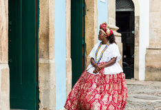 A Brazilian woman of African descent, smiling, wearing traditional clothes from the state of Bahia Stock Photos