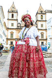 A Brazilian woman of African descent, smiling, wearing traditional clothes from the state of Bahia Stock Images
