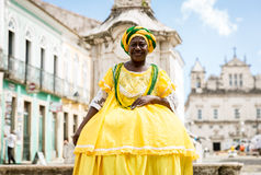 Brazilian woman of African descent wearing traditional clothes from the state of Bahia in the old colonial district of Salvador. Pelourinho Royalty Free Stock Photos