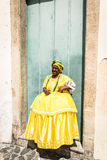 Brazilian woman of African descent wearing traditional clothes from the state of Bahia in the old colonial district of Salvador Royalty Free Stock Images