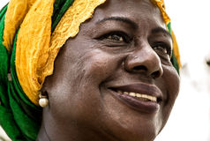 Brazilian woman of African descent wearing traditional clothes from the state of Bahia in the old colonial district of Salvador Royalty Free Stock Photo