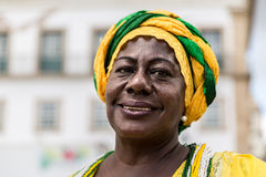 Brazilian woman of African descent wearing traditional clothes from the state of Bahia in the old colonial district of Salvador Royalty Free Stock Photography