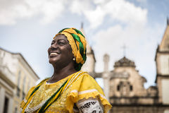 Brazilian woman of African descent wearing traditional clothes from the state of Bahia in the old colonial district of Salvador Stock Images