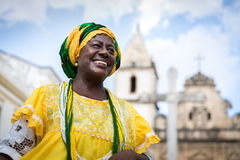 Brazilian woman of African descent wearing traditional clothes from the state of Bahia in the old colonial district of Salvador. Pelourinho Royalty Free Stock Image