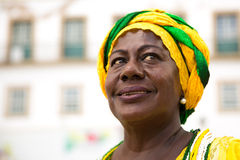 Brazilian woman of African descent wearing traditional clothes from the state of Bahia in the old colonial district of Salvador Stock Image