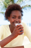 Brazilian woman at beach drinking soda Stock Photography