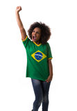 Brazilian woman celebrating on white background Royalty Free Stock Photo