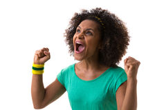 Brazilian woman celebrating on white background Royalty Free Stock Image