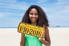 Brazilian woman at Copacabana beach showing sign Rio de Janeiro Royalty Free Stock Photos