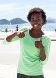 Brazilian woman at Copacabana beach showing thumbs Royalty Free Stock Images