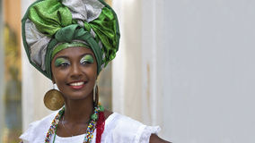 Brazilian Woman Dressed in Traditional Baiana Attire in Salvador, Bahia, Brazil. Brazilian woman of African descent, smiling, dressed in traditional Baiana Royalty Free Stock Images