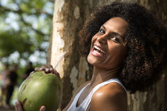 Brazilian woman drinking coconut water in the park Stock Image