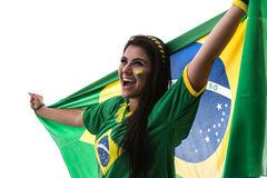 Brazilian woman fan holding the flag of Brazil on white background royalty free stock photo