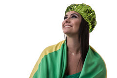 Brazilian woman fan holding the flag of Brazil on white background royalty free stock image