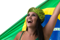 Brazilian woman fan holding the flag of Brazil on white background stock images