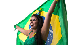 Brazilian woman fan holding the flag of Brazil on white background royalty free stock images