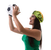 Brazilian woman fan holding soccer ball on white background Royalty Free Stock Photos