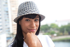 Brazilian woman with hat looking at camera Royalty Free Stock Photography