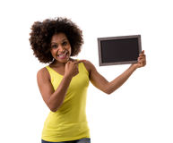 Brazilian woman holding a empty blackboard on white background Royalty Free Stock Photos
