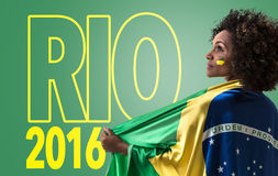 Brazilian woman holding the flag of Brazil and the Text: Rio 2016 Royalty Free Stock Image