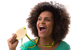 Brazilian woman holding a gold medal on white background Stock Images