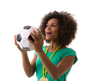 Brazilian woman holding a soccer ball on white background Royalty Free Stock Photo
